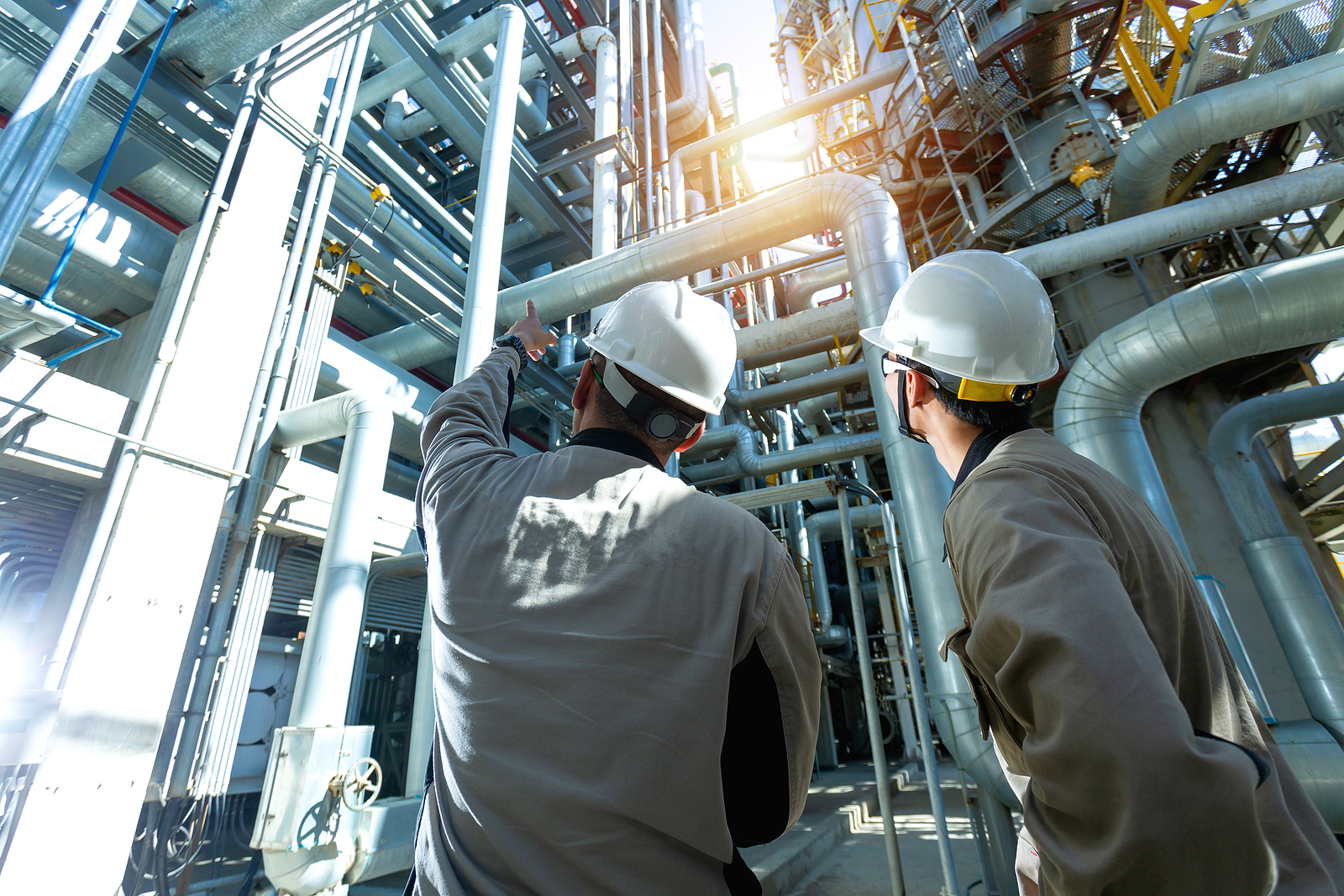 Photo of Industrial Engineer Or Worker Checking Pipeline At Oil And Gas R